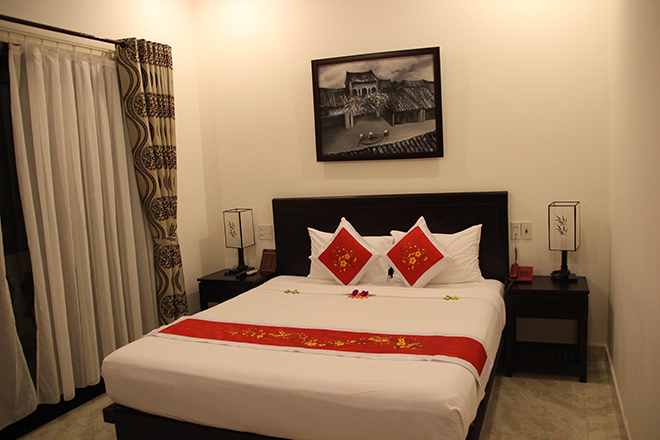 Grand lit Pham Gia Boutique Homestay Hoi An Vietnam
